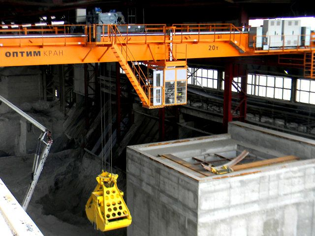 Optim-Crane Overhead travelling crane with a grapple
